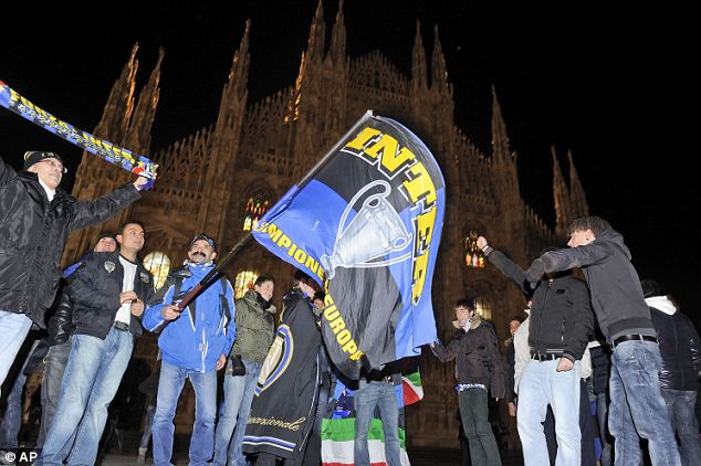 Inter fans celebrate in Milan's Duomo square after their team's success