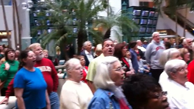 Weary travellers were treated to a spontaneous outbreak of singing at Orlando International Airport