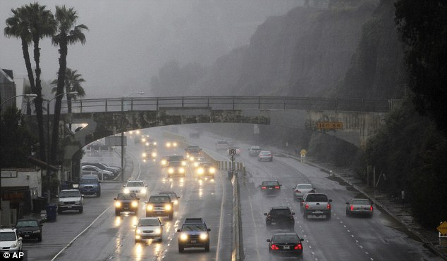 Deluge: Motorists struggle with torrential conditions on the Pacific Coast Highway, in Santa Monica, California