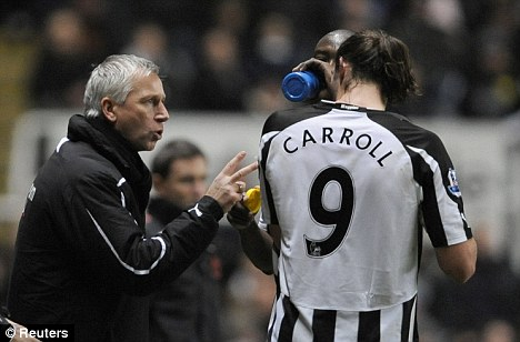 Top talent: Alan Pardew (left) rates Carroll as Newcastle's best player