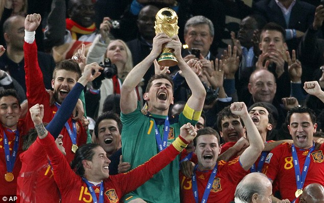 Viva Espana! Iker Casillas, Spain's captain, lifts the World Cup trophy