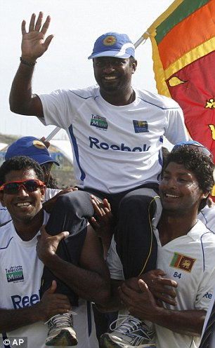 National hero: Muttiah Muralitharan is carried on the shoulders of his Sri Lanka team-mates after his final Test match
