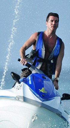 beach boy: Simon Cowell jetskiing in Barbados