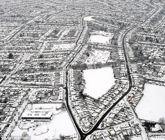 Colourless landscape: South London looks bleak from the air with very little colour visible
