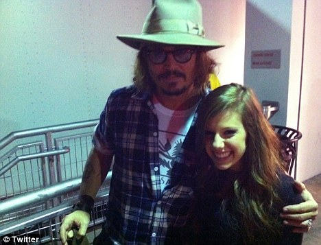 Bieber fever: Johnny Depp poses with singer/songwriter Avery backstage at the Justin Bieber concert last night in Miami