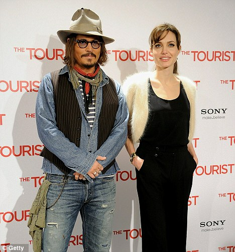 Busy man: Johnny just wrapped up a press tour for his new film The Tourist with co-star, Angelina Jolie