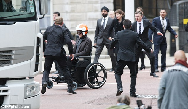 Stunt time: Atkinson's stunt double has a go in the wheelchair as they start shooting scenes for the film