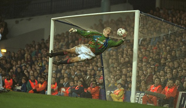 Golden gloves: Schmeichel makes one of his finest saves at Tottenham in 1994