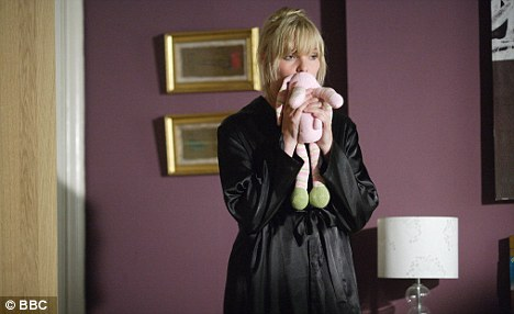 Unhappy viewing: Soaps will have sad and gritty plots over the holiday like a cot death plot in Eastenders