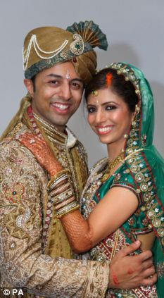 Arrest: Shrien Dewani and Anni Dewani on their wedding day. Anni was murdered on her honeymoon as she and her new husband drove through Cape Town