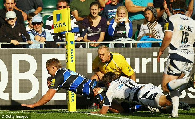 Struggling: Bath's Ben Williams scores a try against Sale in September