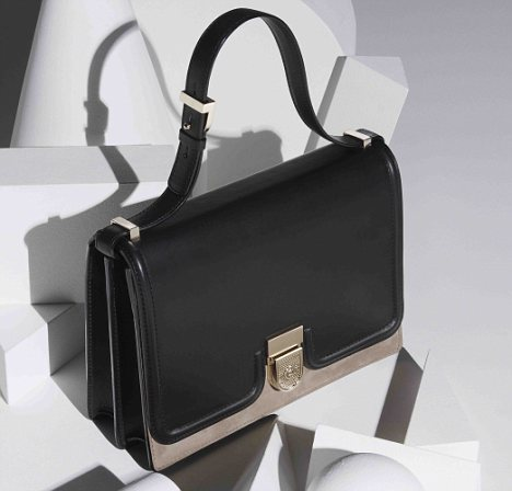 Sellout: Victoria Beckham's £1,700 two-tone shoulder bag sold out within 60 minutes on net-a-porter.com yesterday