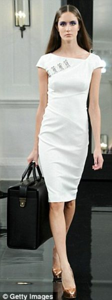 Understated: Looks from Mrs Beckham's New York Fashion Week presentation in September, when the handbag line made its debut