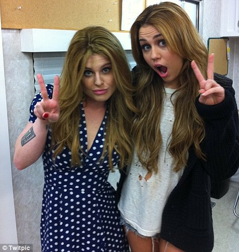 I'm just being Miley! Kelly Obsourne posted a picture of herself with So Undercover co-star Miley Cyrus on the film set