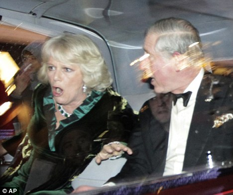 Terror: The Duchess of Cornwall and prince Charles look shocked as their car comes under attack by student protesters