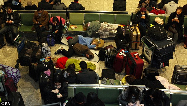 Passengers sleep on the hard floor of Terminal 3 as flights are delayed or cancelled