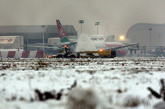 Snow ploughs clear the southern runway at Heathrow Airport, as travel chaos continues