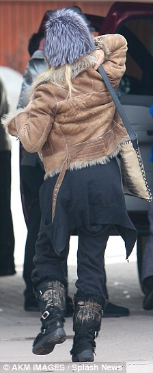 ...replacing the furry cropped tan jacket she started the day in