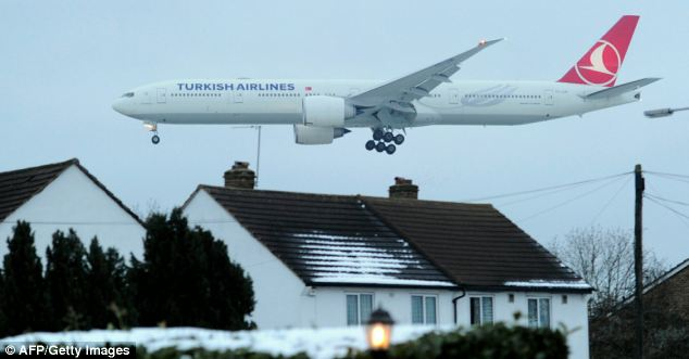 Working again: A Turkish Airlines plane prepares to land at Heathrow yesterday after both runways were opened for the first time in days