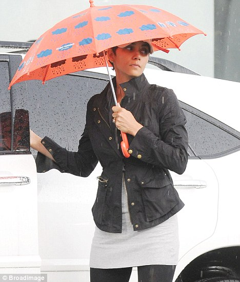 Braving the rain: Halle Berry managed to look chic as she stepped out in a rainy Los Angeles yesterday