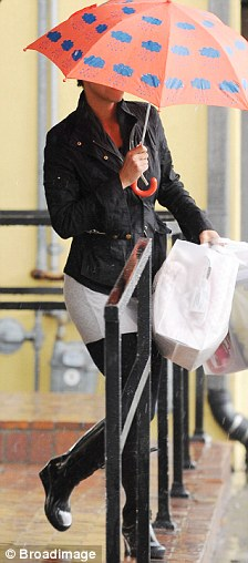 Walking on the wild side: Halle wore a pair of wedge wellington boots for her last-minute Christmas shopping trip