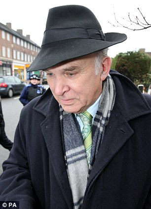 Business Secretary Vince Cable leaves his home in Twickenham, south London after he was stripped of his responsibilities for the media