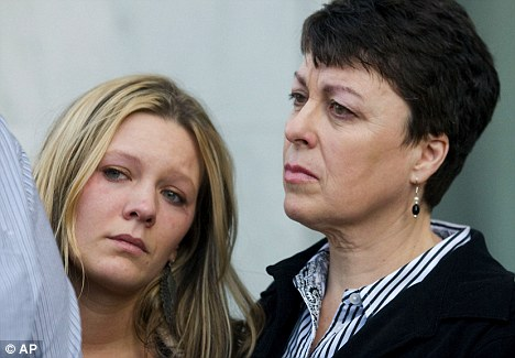 Grief: Jamie Lewis, left, the former fiancee of Joshua Turnidge, stands with Eileen McRoberts, sister of Bruce Turnidge, outside court in Salem, Oregon, after the death sentence was given