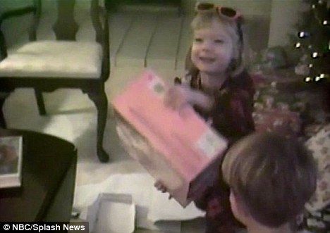 Festive excitement: Emma with her brother Spencer opening Christmas presents