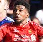 Chelsea's Gary Cahill battles for the ball with Liverpool's Jerome Sinclair (right)