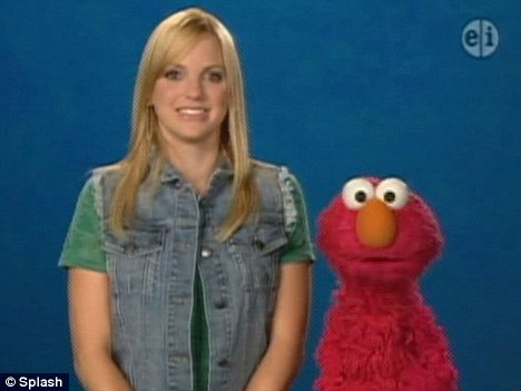 Lucky lady: Film star Anna Faris gets given a gift by Elmo during her appearance on Sesame Street