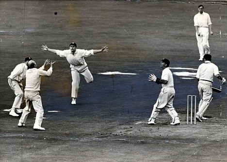 Bagged: Tony Lock catches Jimmy Burke off Laker's bowling