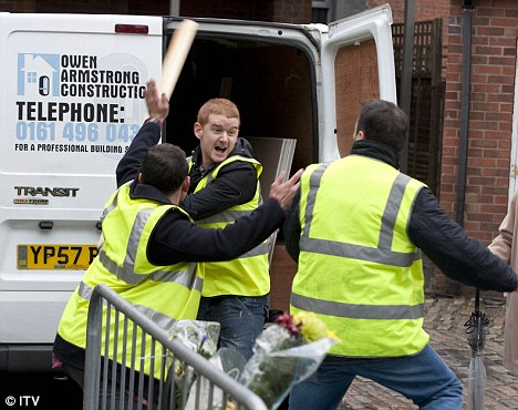 Drama: Gary Windass (Mikey North) goes for Owen Armstrong (Ian Puleston-Davies) after getting locked in a van on Coronation Street