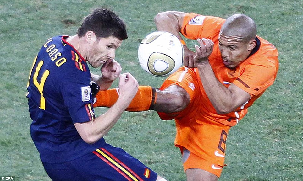 Holland's Nigel de Jong sticks the boot into Spain's Xabi Alonso during the World Cup final at the Soccer City stadium in Johannesburg, South Africa