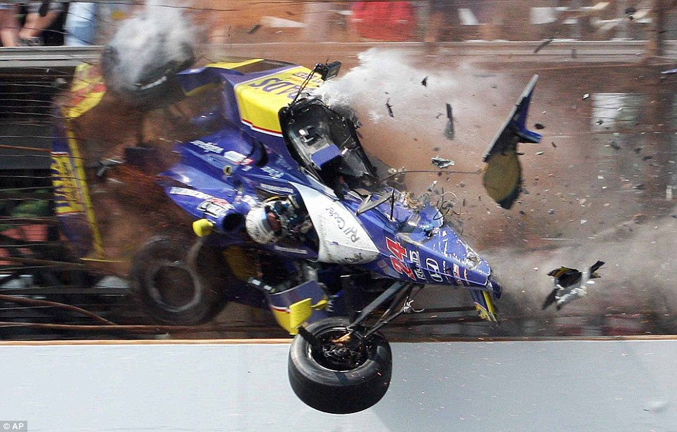 Mike Conway crashes into the fencing in the third turn during the Indianapolis 500 race at Indianapolis Motor Speedway