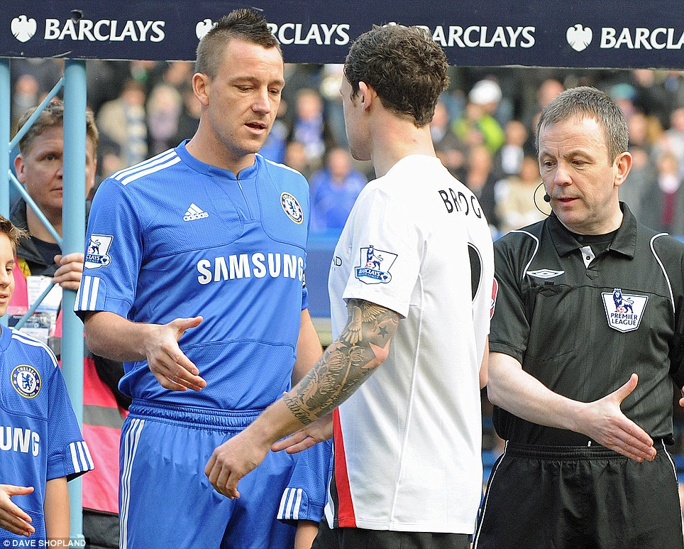 Wayne Bridge ignores the handshake of John Terry after allegations that the Chelsea skipper had cheated with his girlfriend
