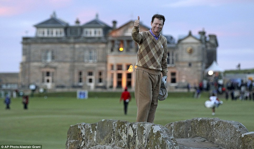 Tom Watson stands on the Swilken Burn bridge and gives the thumbs up on his final round at St Andrews during the second round of the Open