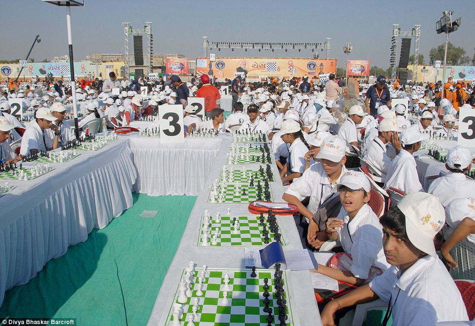 Chess fest: Players in one iof the white table areas  help smash a record held for four years