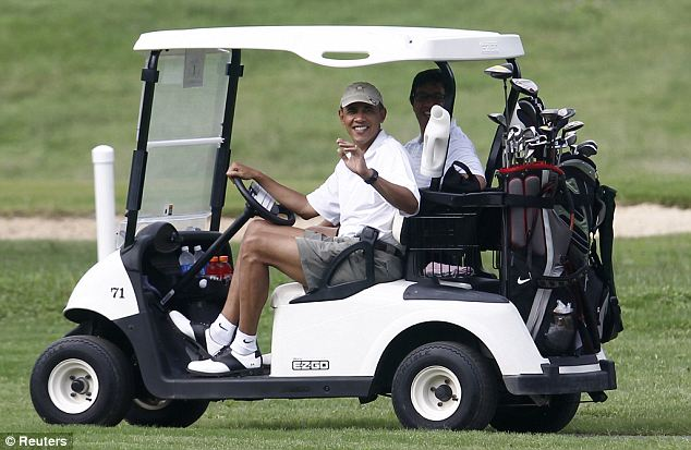 President Obama took a turn behind the wheel as he drove friend Mike Ramos around the Mid-Pacific Country Club in Kailua, Hawaii during a leisurely round of golf