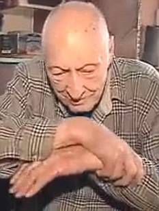 Lester Matteson, 92, shows how he managed to chew masking tape from his hands after being tied up by two men who took his car and $400