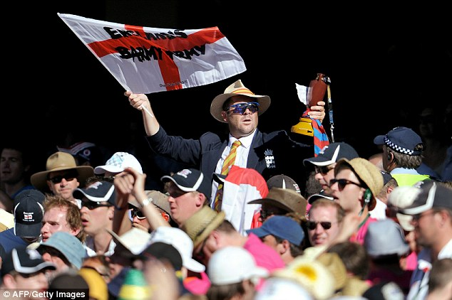 Brit abroad: A Barmy Army flag in one hand, sporting an MCC tie and Panama hat, and a fake Ashes urn in his other hand