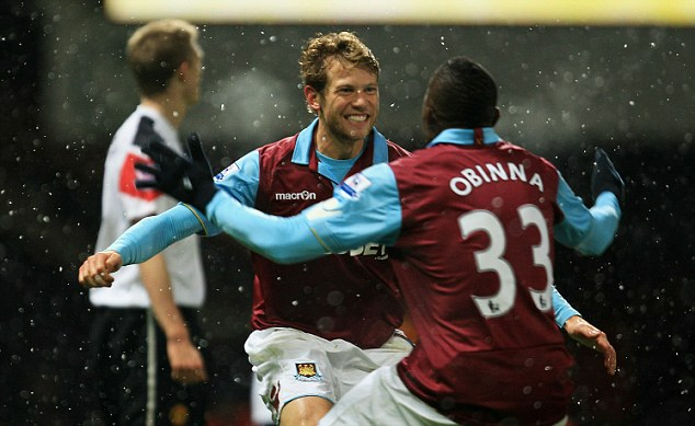 This one counts! Jonathan Spector celebrates his opening goal with Victor Obinna against Manchester United, moments after West Ham saw a strike controversially ruled out for offside