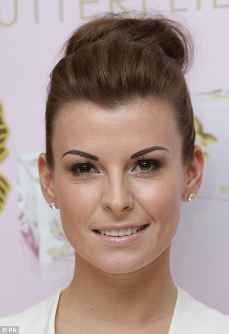 The painted look: Coleen Rooney arrived at her perfume launch today sporting dark thick eyebrows