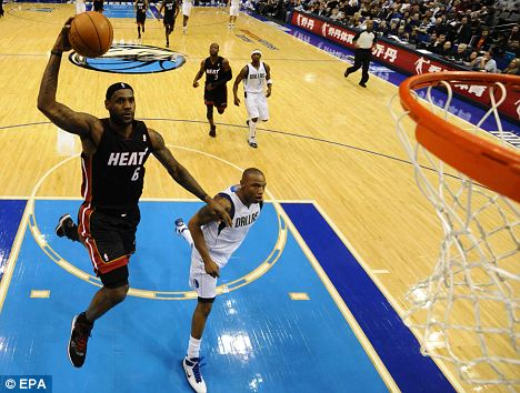 Super six: LeBron James (left) goes for the dunk against Dallas at the weekend