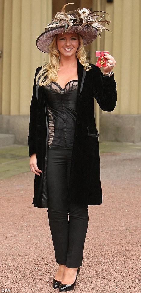 Reunited: Lingerie tycoon Michelle Mone holds up her OBE at Buckingham Palace last Thursday, an  award she thought she'd lost forever