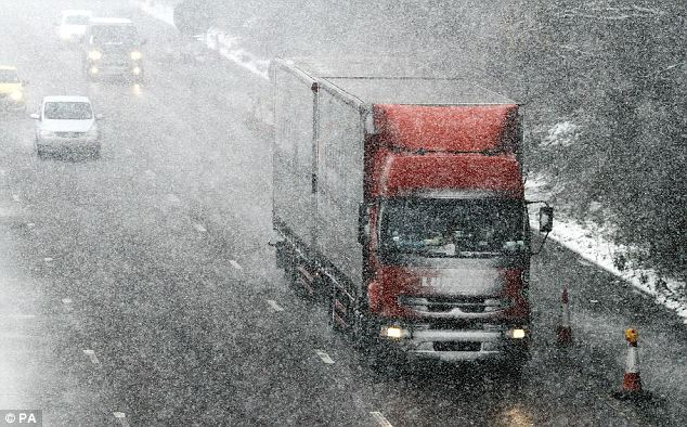 Driving blind: Lorries face difficult conditions on the M20 near Ashford, Kent