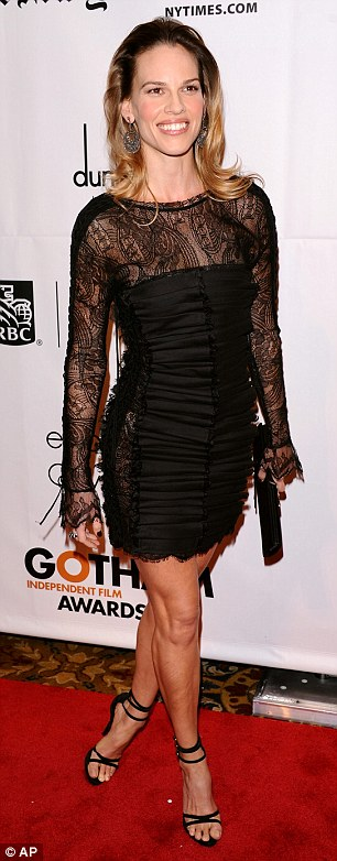 Sexy lady! Hilary Swank was sultry in a black lace minidress and strappy black heels