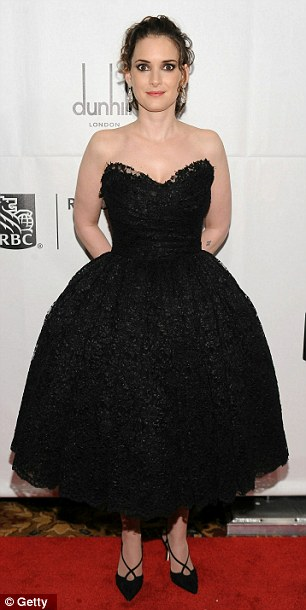 Tiny dancers: Winona Ryder and Amber Tamblyn both opted for dark below-the-knee-dresses