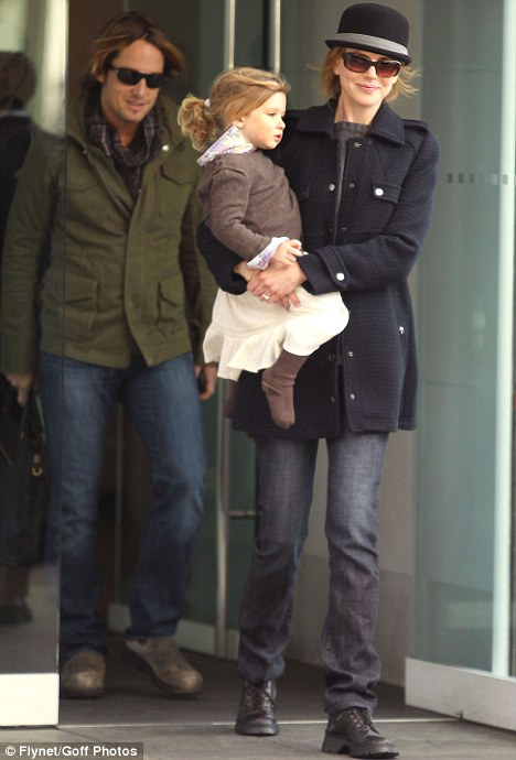 Happy families: Keith Urban, wife Nicole Kidman and their daughter Sunday Rose leave their apartment in New York City last week