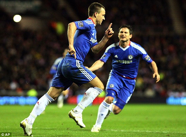 Captain marvel: Terry (left) celebrates putting Chelsea back in front