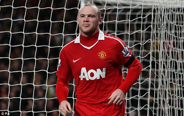 Double trouble: Rooney scored his second goal on the stroke of the interval
